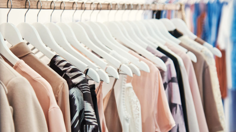 An image of a clothing rack with woman's clothing hanging up.If needing a good Foster City wage and hour lawyer, call our employment law office today.