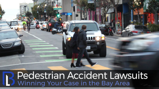 Image of pedestrians crossing the street for a San Francisco pedestrian accident lawyers.