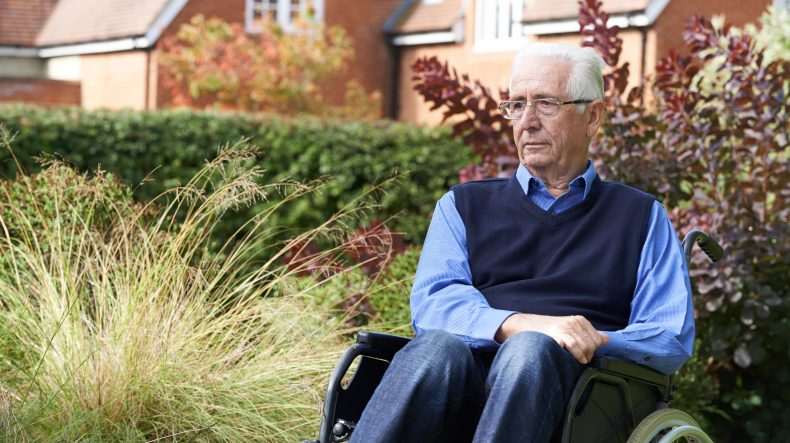 Sad older man sitting in wheelchair outside alone, the San Francisco Nursing Home Injury Attorney can assist your loved one's injury case.