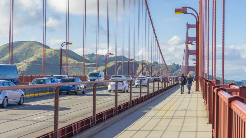 Cars drive over Golden Gate Bridge after calling a San Francisco car accident lawyer.