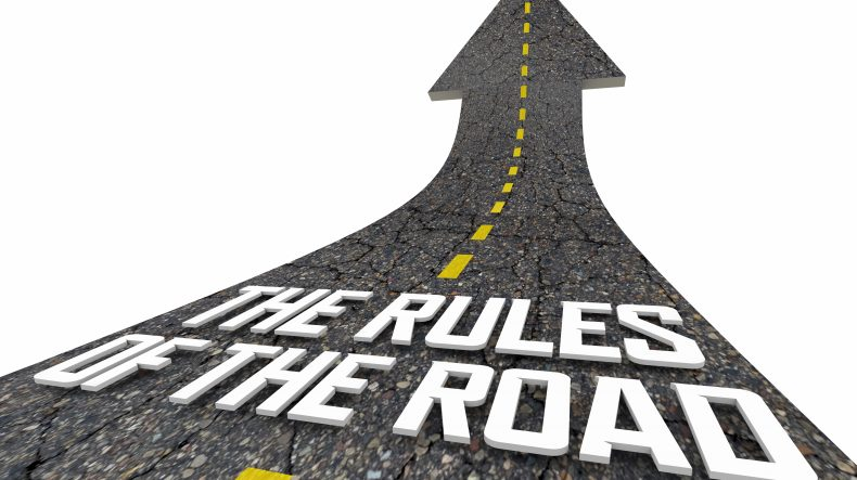 A road with the words 'the rules of the road,' meet with a California Auto Accident Lawyer to discuss your case.