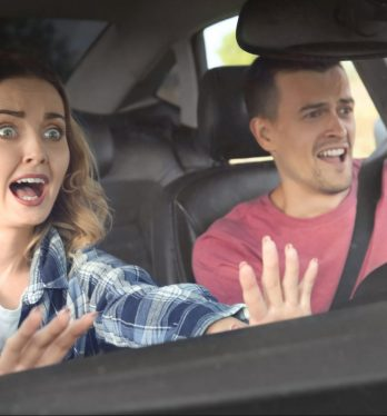 A couple in a car reacting to an oncoming accident, for help with injury claim speak to San Francisco Car Accident Injury Attorney.
